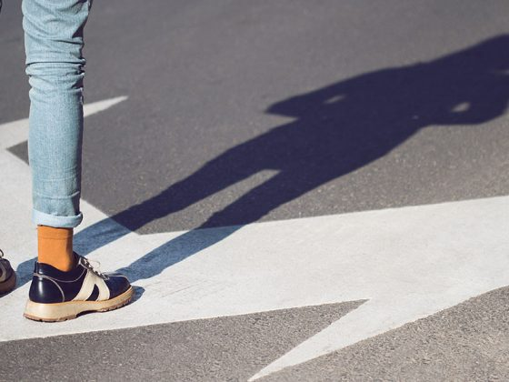 Someone standing in a road lane | Motif