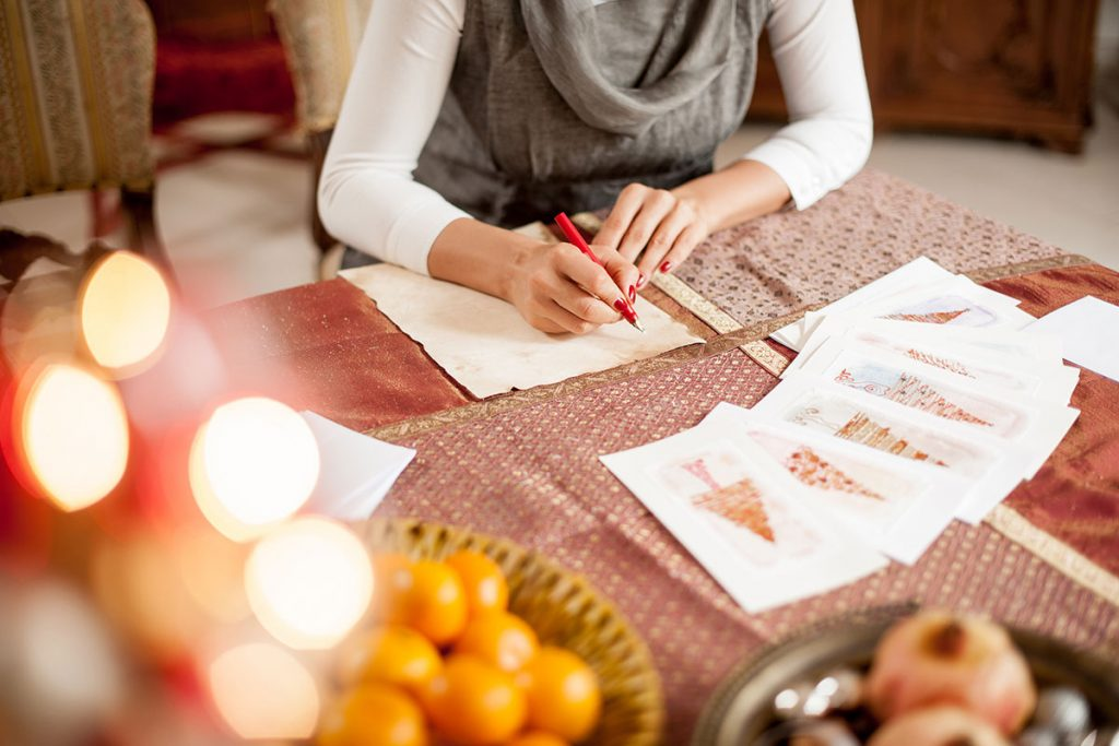 A woman getting ready to write a letter   Motif