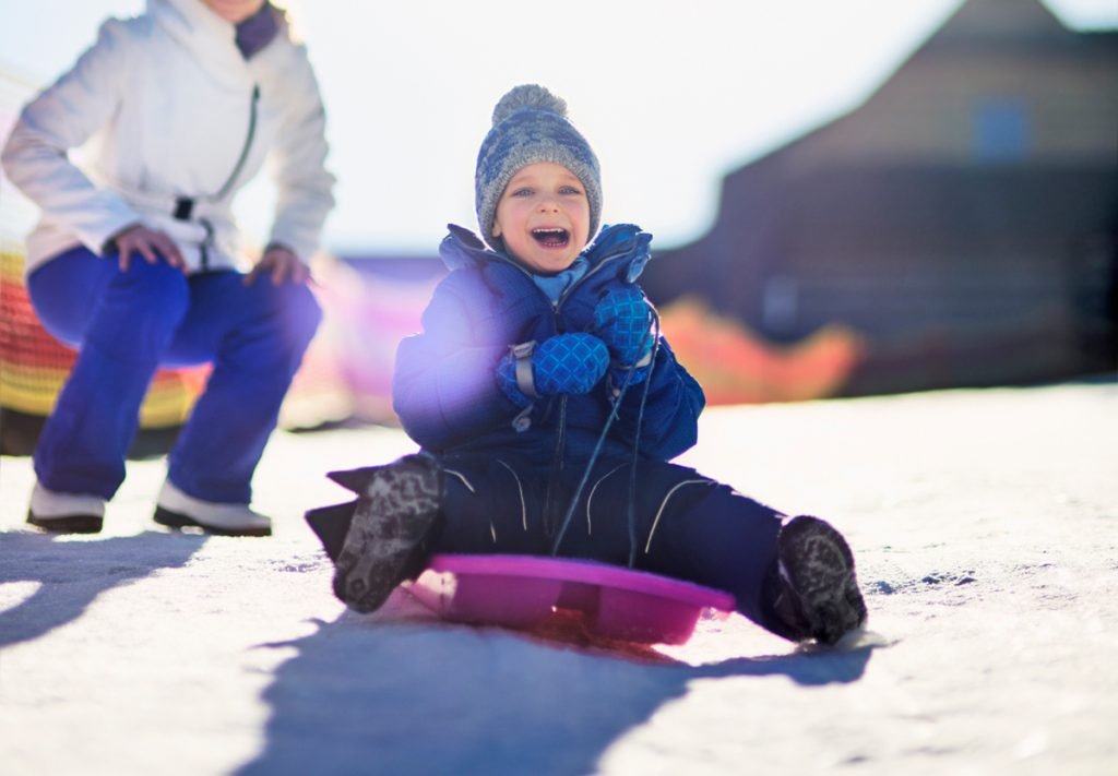 Boy Sledding Photography with Cold Winter Tones