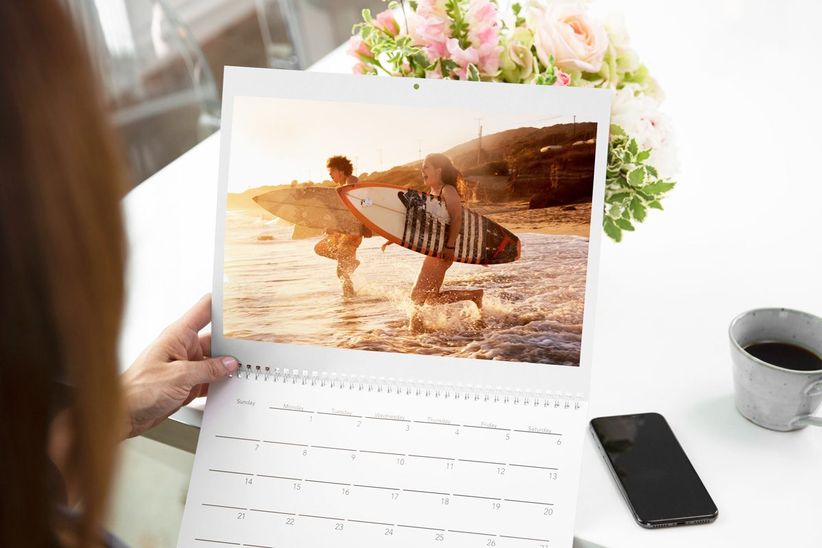 A custom calendar with two kids surfing | Motif