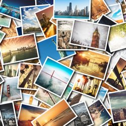 A large number of photographs on a table | Motif