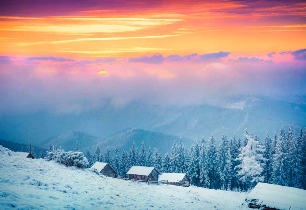Snowy Hillside During Sunset