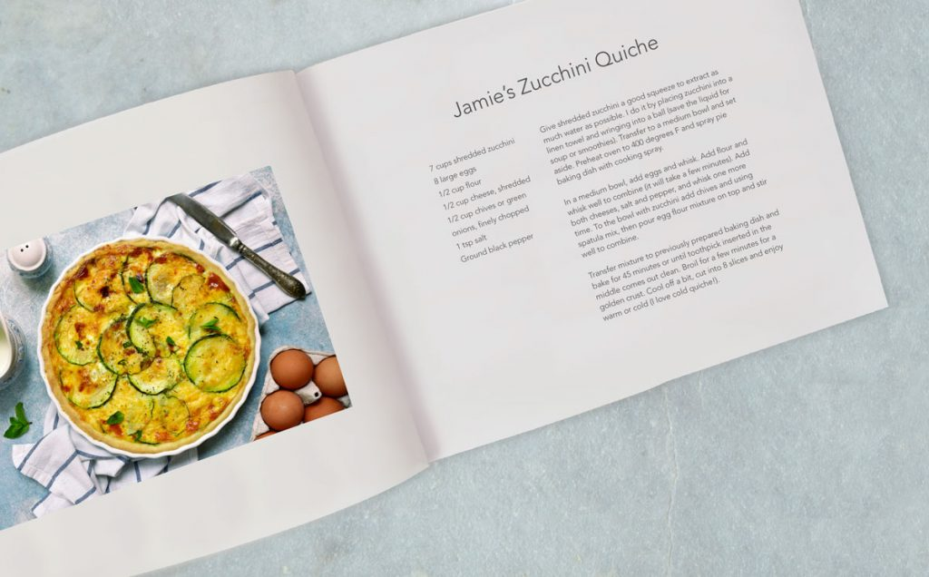 "A recipe book with a page for ""Jamie's Zucchini Quiche"" 
