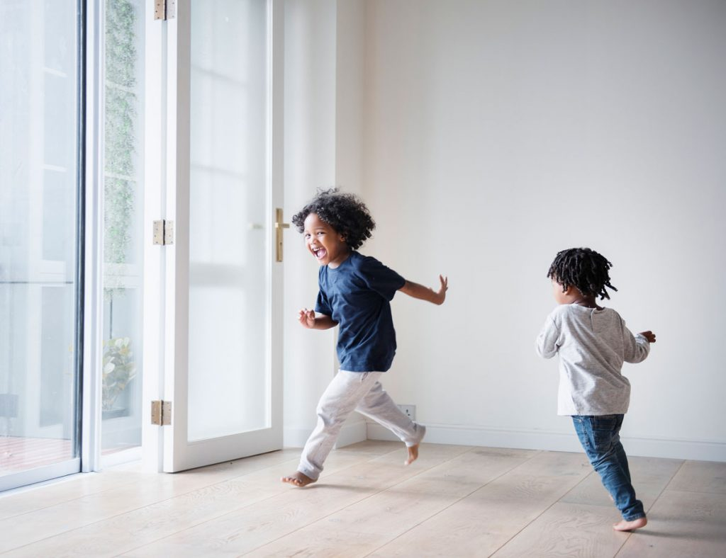 Two kids running and playing inside | Motif