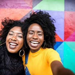 Best Friends Selfie by a Colorful Wall | Motif