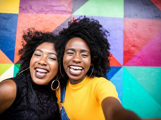Best Friends Selfie by a Colorful Wall