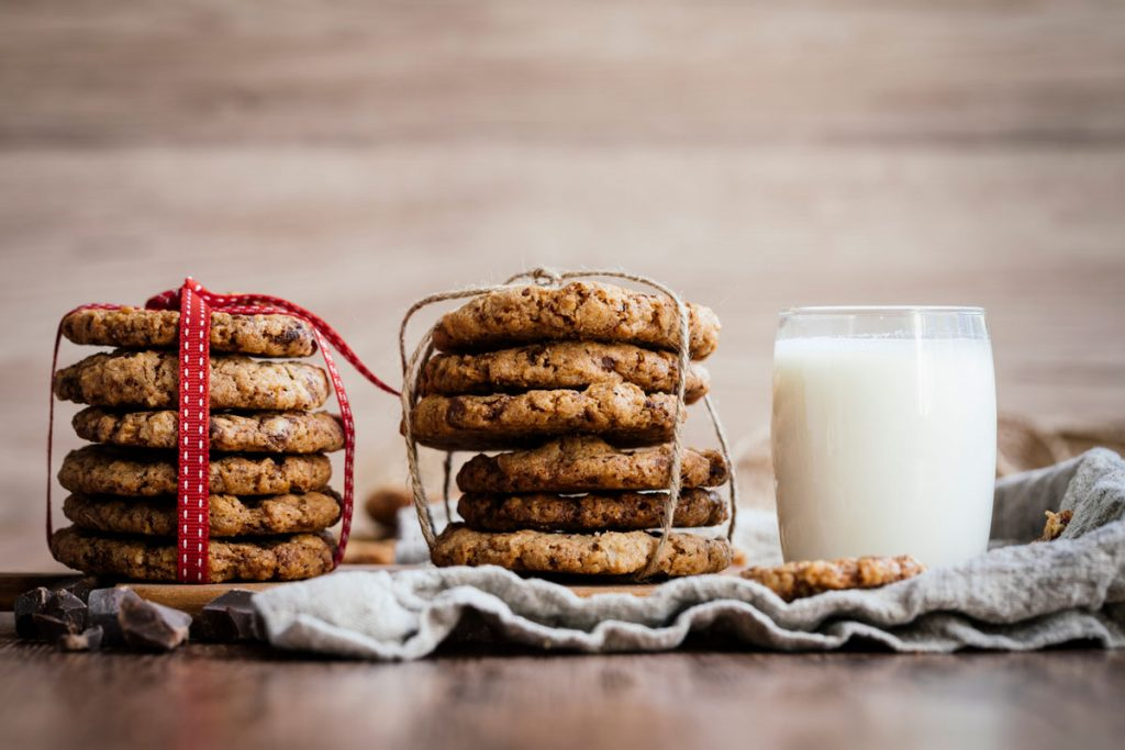 Two stacks of cookies and a glass of milk | Motif