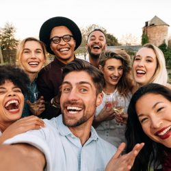 Friends making a selfie together at party | Motif