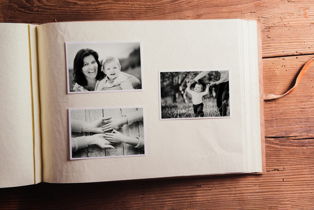 Putting physical photos in a Mother's Day photo album | Motif