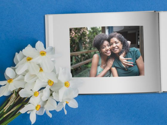 A Mother's Day photo album next to flowers | Motif