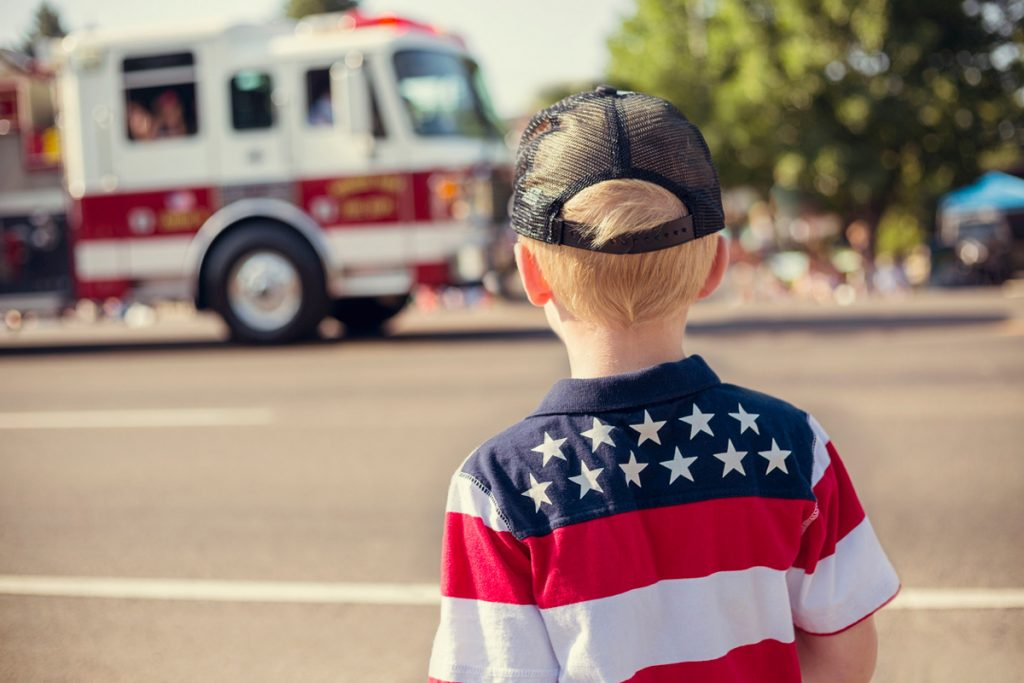 Little Boy Watching Fourth of July Parade | Motif