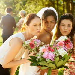 The bride and her friends taking a selfie for a wedding photo | Motif