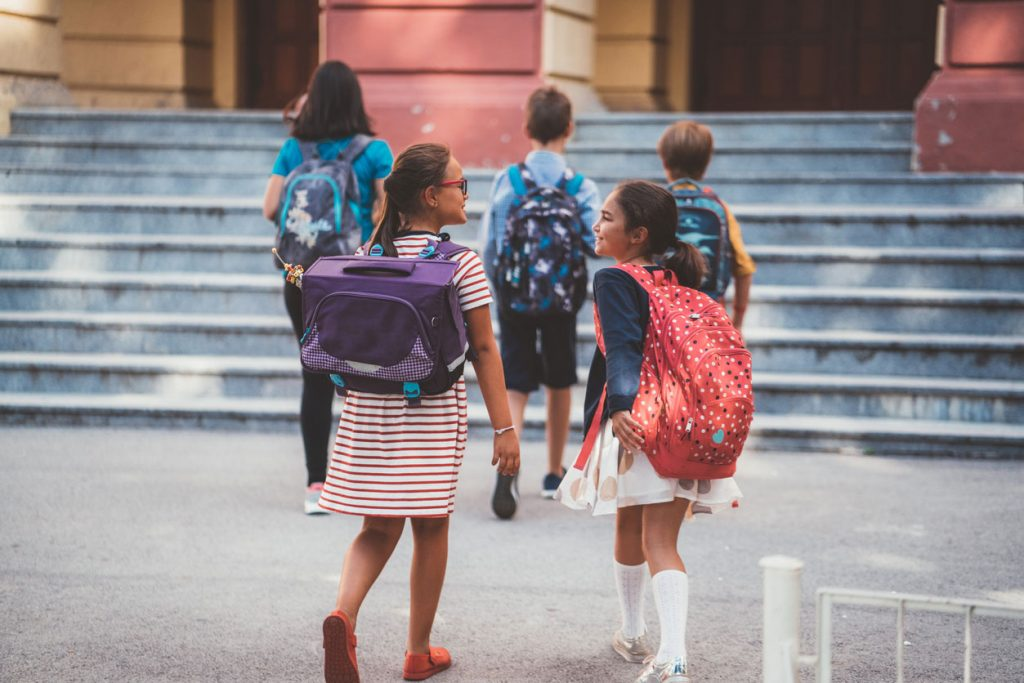 Friends walking together on the first day of school