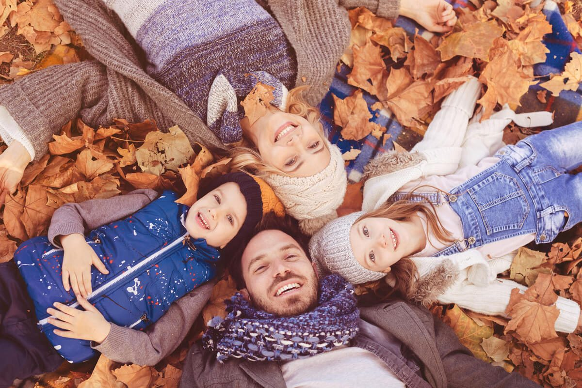 Fall family photo in a pile of leaves