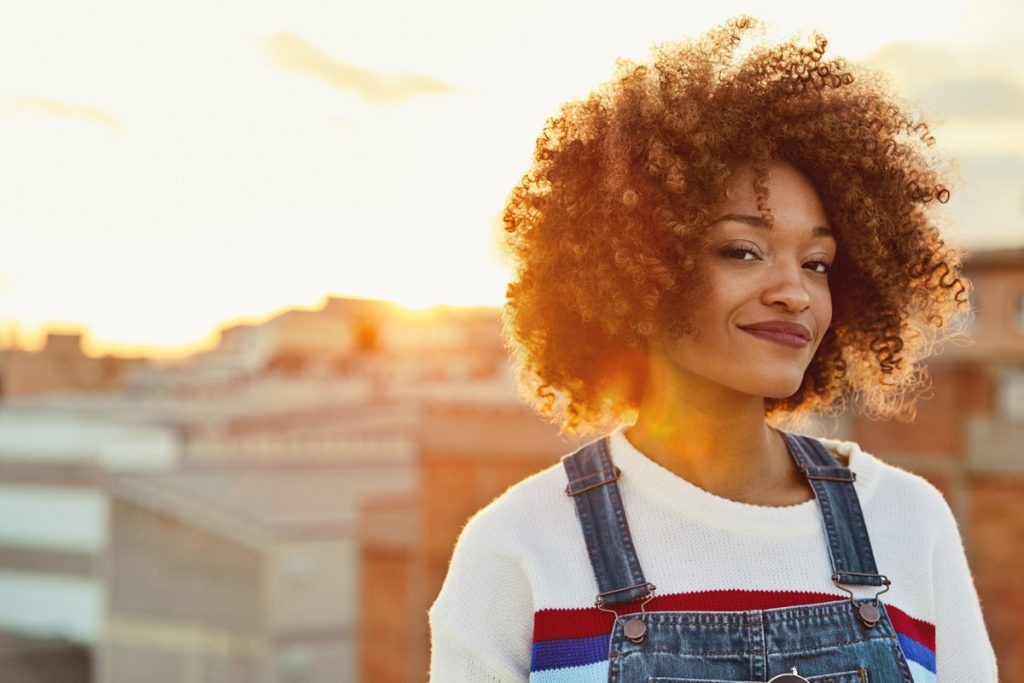 Portrait of young woman on a rooftop during the golden hour.