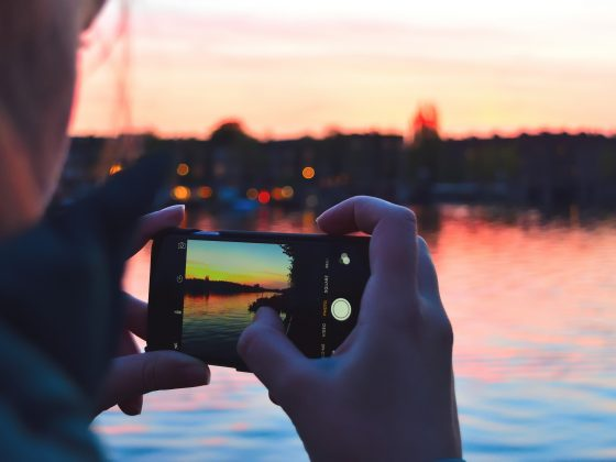 Taking a picture of the sunset over water on an iPhone | Motif