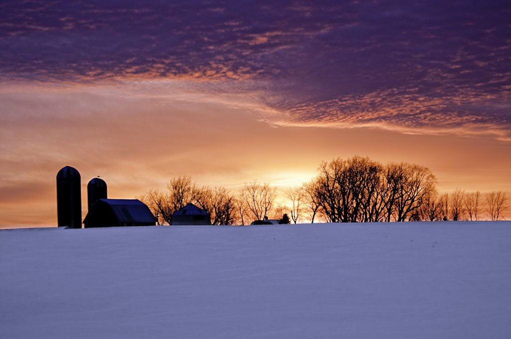 Use these snow photography tips to capture snow against a colorful sky | Motif