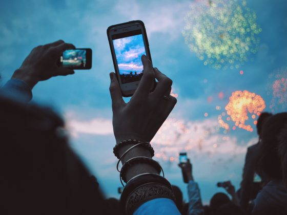 Taking a picture of a fireworks show on your phone.