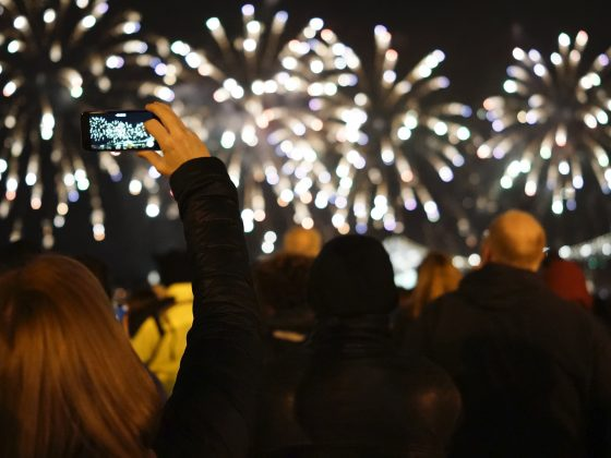 Taking photos at night with fireworks going off.