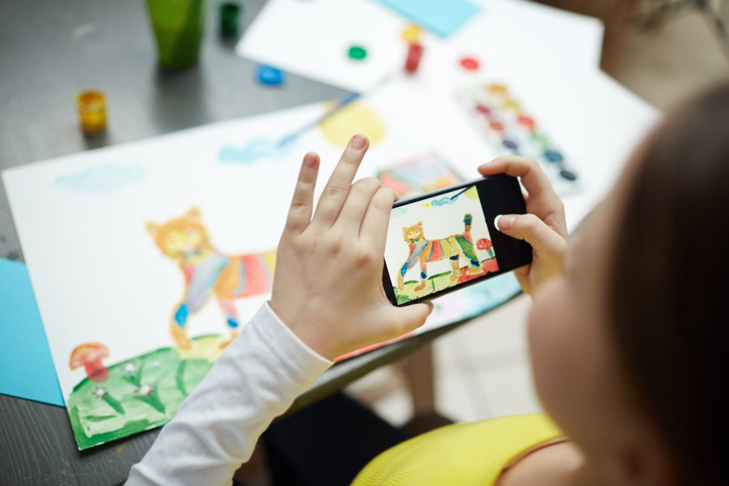 Follow these tips to take photos of your children's artwork with an iPhone.