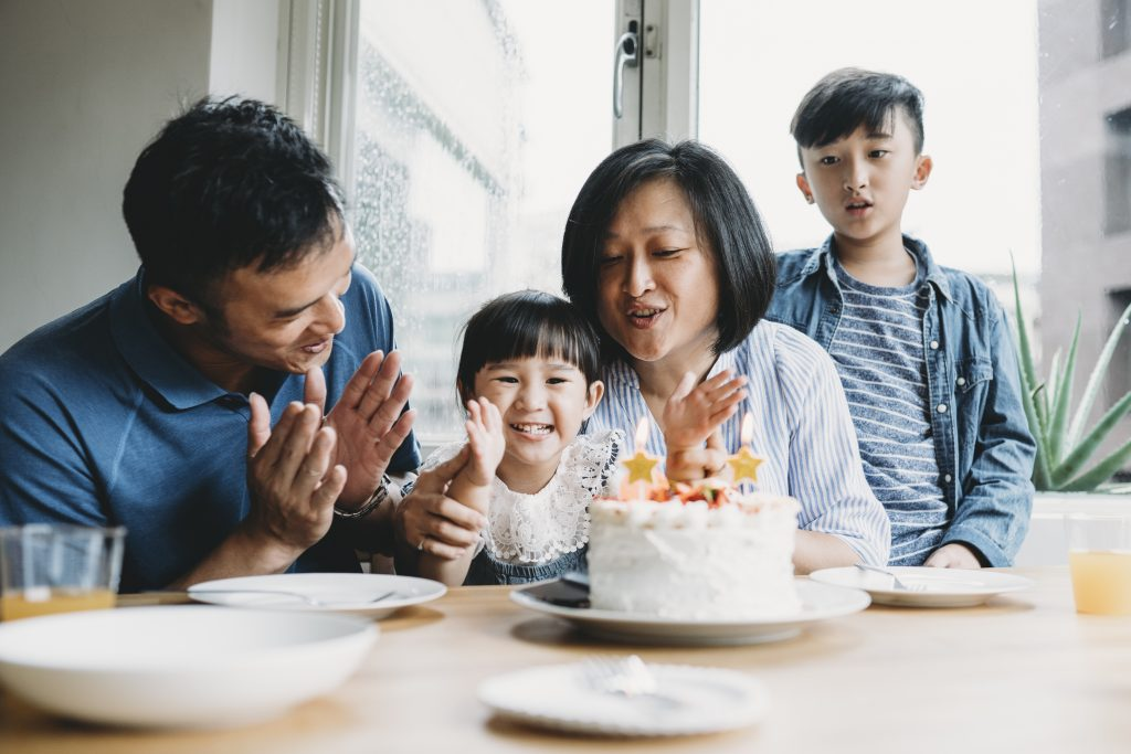 A thinking of you card can include a photo of Mom, Dad and brother celebrating sister's birthday.