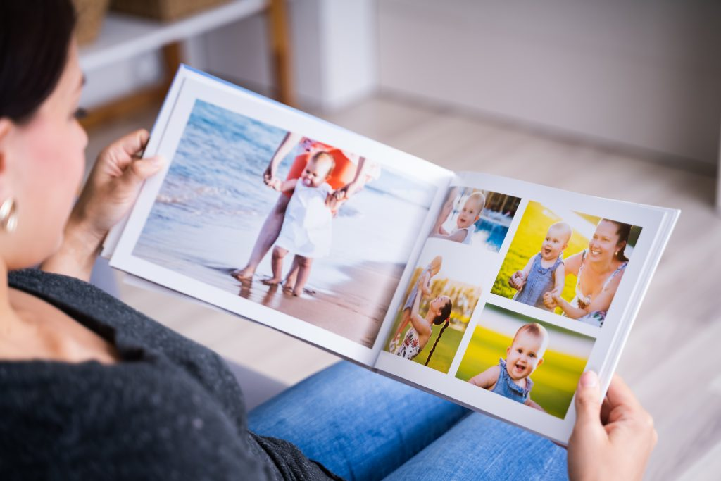 A photo book with different layouts shown.