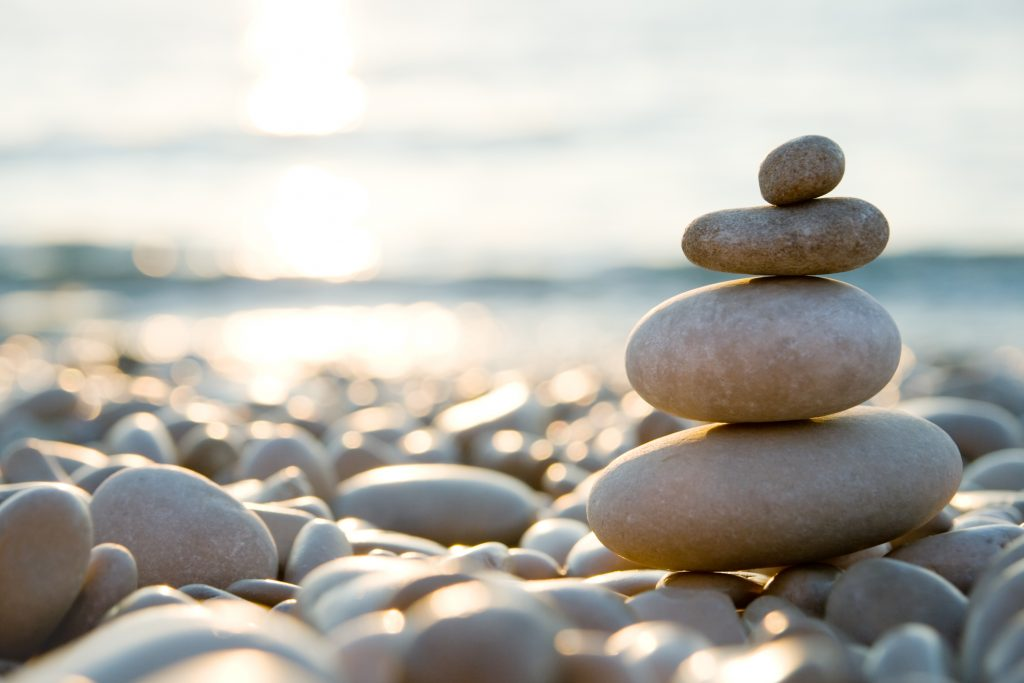 This example of nature photography uses the rule of thirds for a closeup of beach pebbles.