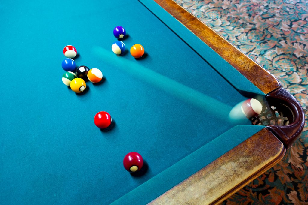 An example of rear curtain flash sync on a pool table.