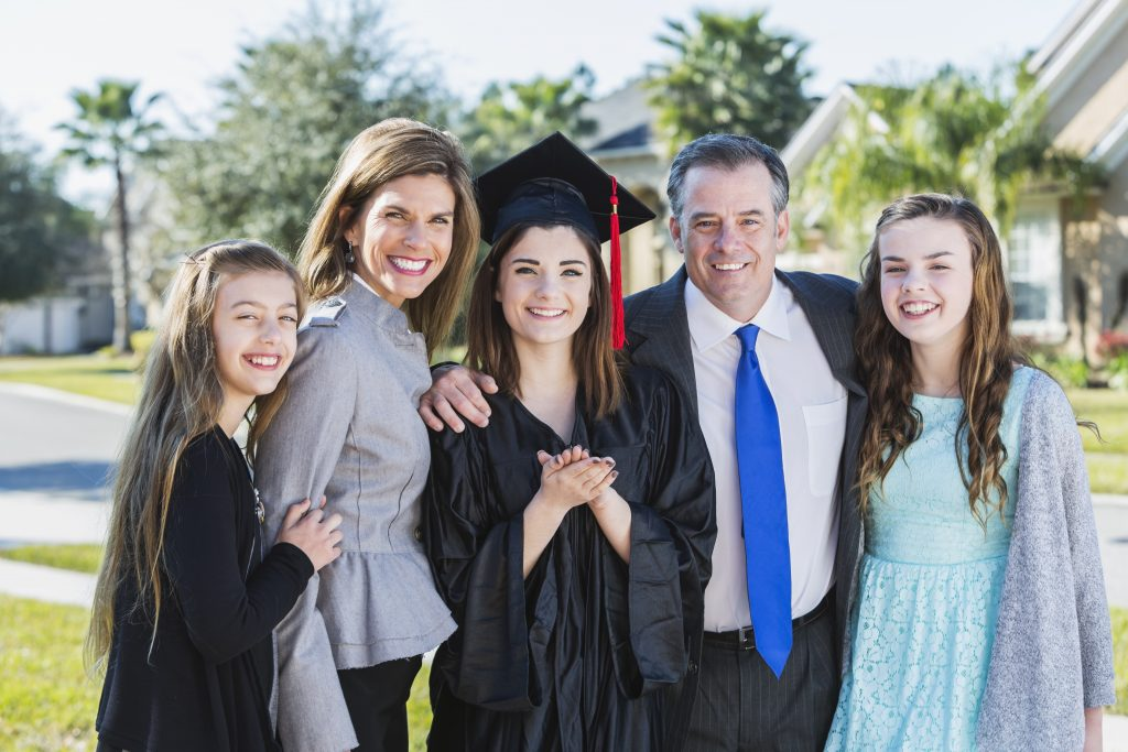 Set up a family photo with your high school graduate to include in a personalized yearbook.