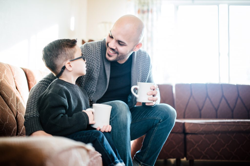 Include a pic of Dad drinking coffee with his son in your Father's Day photo book.
