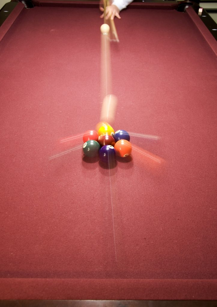 An example of front curtain flash sync on a pool table.