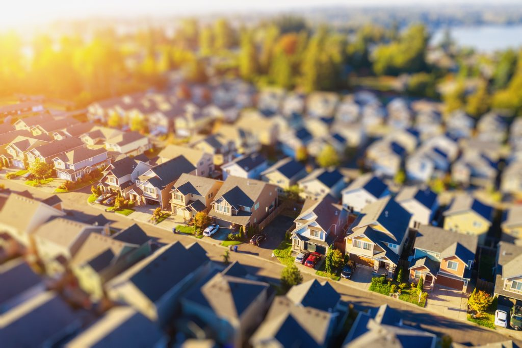 This neighborhood aerial was taken with tilt-shift lens to make homes appear miniature.