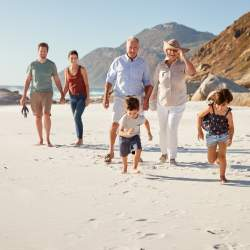 Your summer family picture can be portrait-style on the beach with multiple generations.