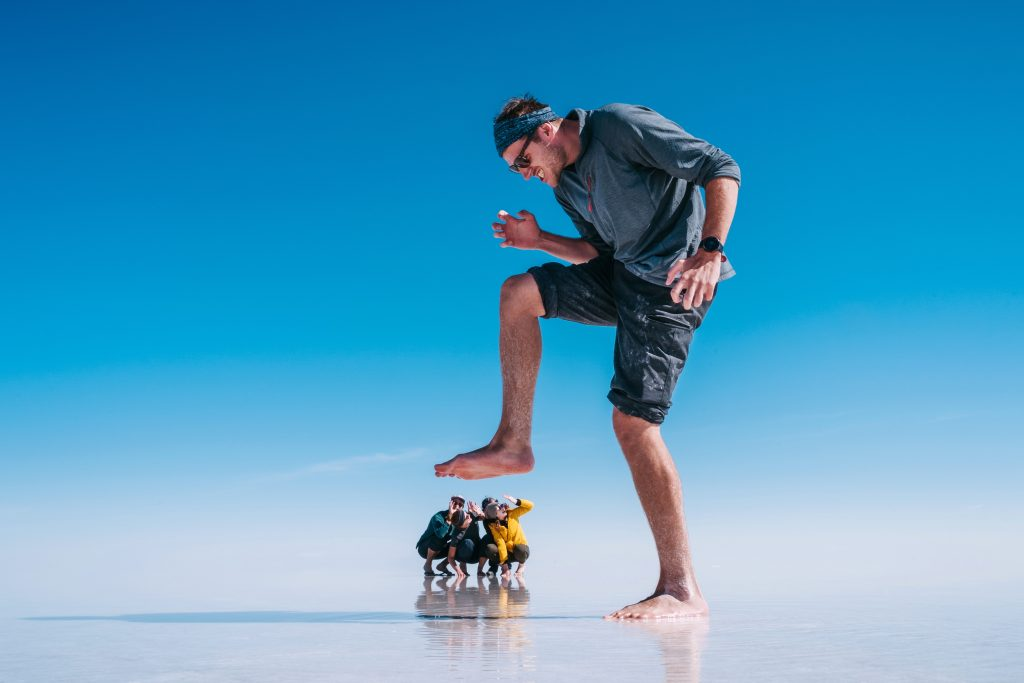 "A forced perspective shot of a man ""stomping"" on his friends like a giant."