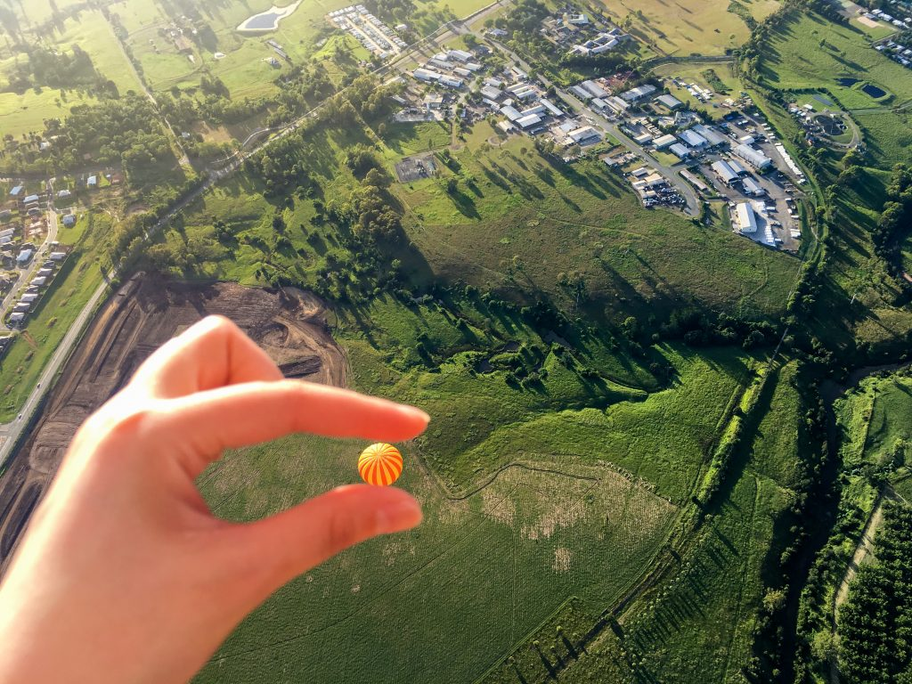 With forced perspective photography, make your hand hold a hot air balloon above ground.