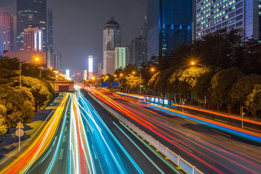 These night photography tips explain how to create streaking lights from cars on city streets.
