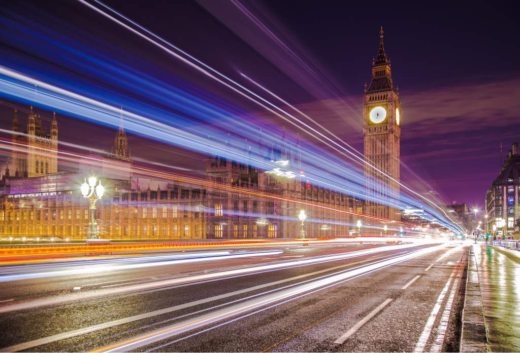 Use these night photography tips to capture streaking car lights on street in front of Big Ben.