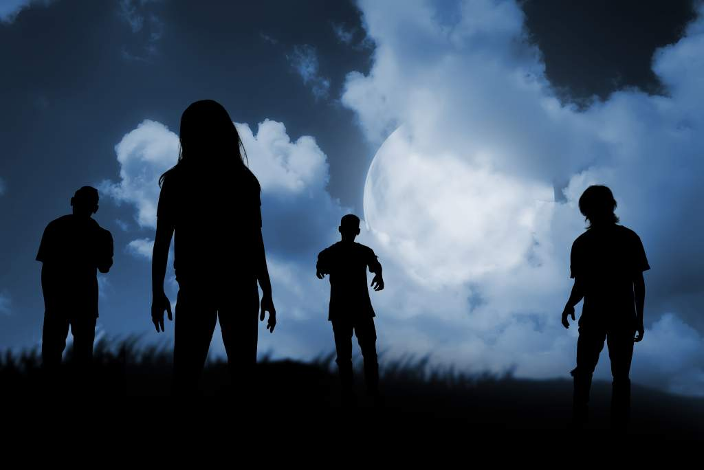 A group of zombies walking at night make for a spooky Halloween photo idea.
