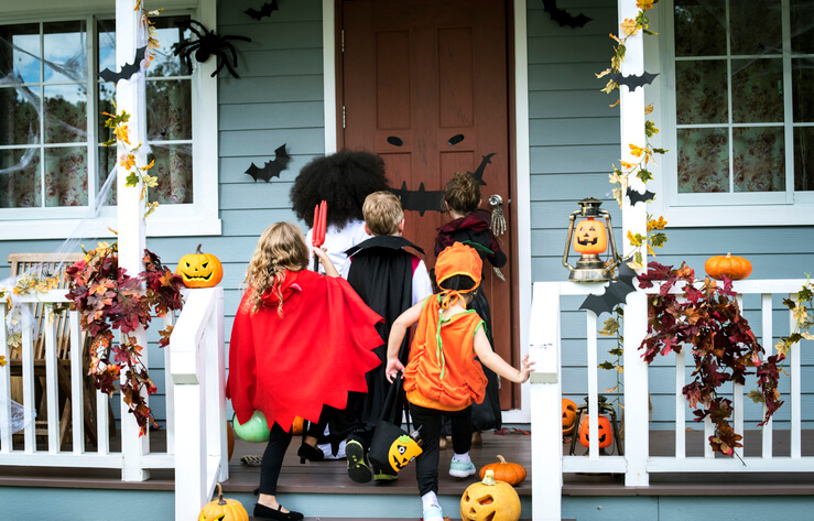 Kids trick-or-treating is one of the harder Halloween photoshoot ideas, but it's worth it.