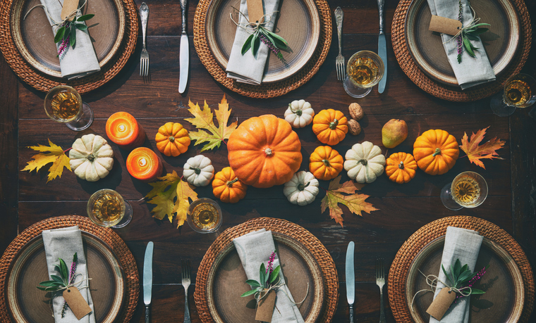 Overhead shot of place settings and pumpkins on the table is a great Thanksgiving photo card.
