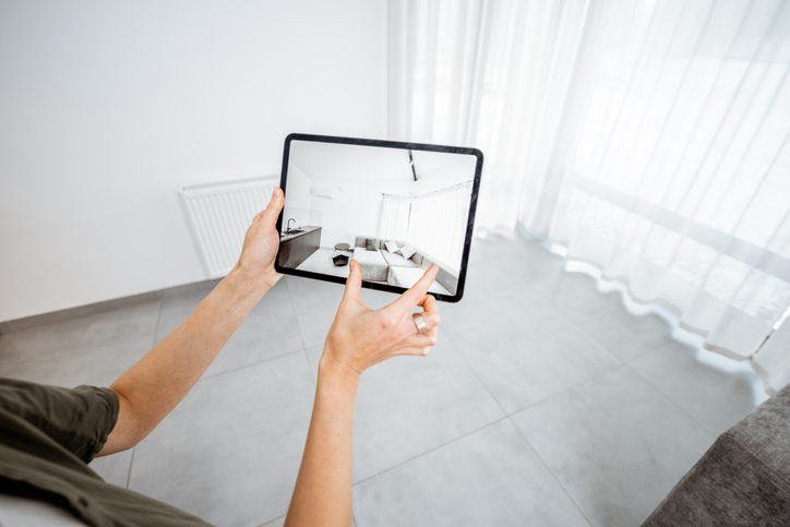 Realtor takes photography on iPad to capture unique selling points of a home.