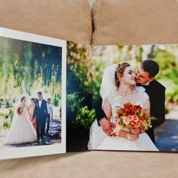 An open wedding album on a sofa shows happy newlyweds know how to create Apple photo book memories.