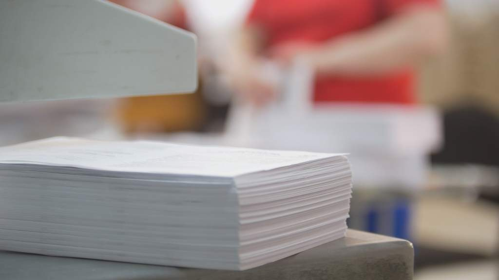 A stack of high-quality paper used to create Apple photo book designs.