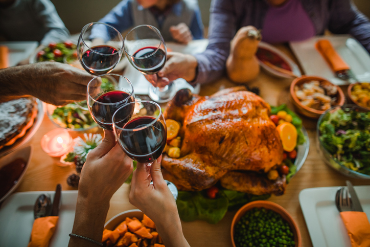 Dinner table with turkey & people clinking glasses of red wine makes great Christmas pictures.