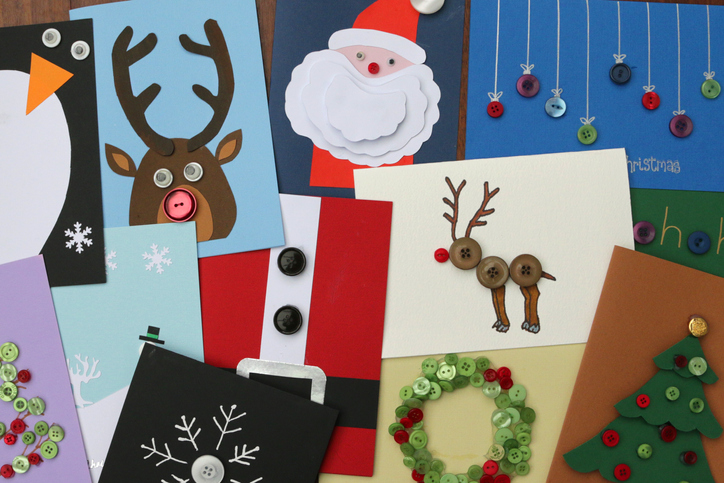 Various DIY Christmas cards in a pile to show you all the possible ideas you can create.