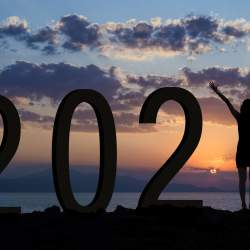 Woman at sunrise as the number 1 in the 2021 year date