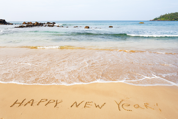 Writing 'Happy New Year' in the sand by the water is one of the easiest New Year's Eve pictures.