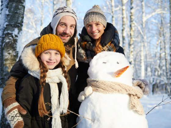Family Posing with Snowman