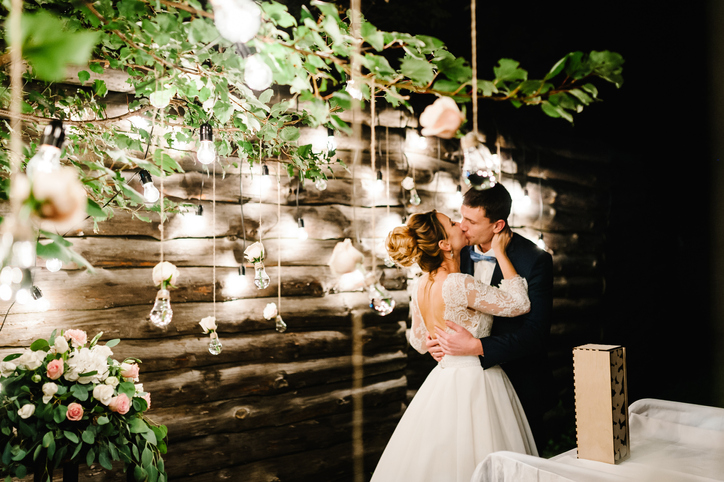 A wedding photo wall is a unique backdrop where guests can take photos.