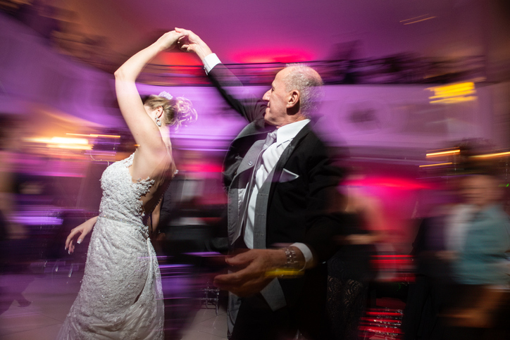 Candid wedding photos means a lot of dancing shots.